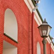 Old building from a red brick and a lantern — Stock Photo