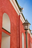 Old building from a red brick and a lantern — 图库照片