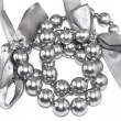 Silvery pearl necklace with bows — Stock Photo