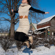 Yang lady jumping at winter time — Stock Photo #4577221