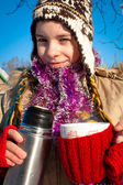 Girl holding a cup with hot drink — Stock Photo