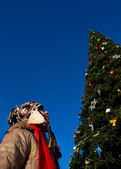 Girl looking at the Christmas tree — Stock Photo