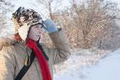 Teen girl looking far away at snowy winter day — Stock Photo