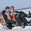 Happy sisters sledding at winter time — Stock Photo #4810827