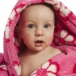 Stock Photo: Little baby boy dressed in rosy bathrobe
