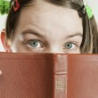 Surprised teen girl with the Bible — Stock Photo
