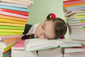 Teen girl sleeping on the stack of books — Stock Photo