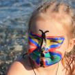 Child's face painted as butterfly — Stok fotoğraf