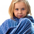 Beautiful girl in blue blanket — Stock Photo
