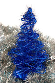 Christmas tree in tinsel isolated against white background — Stock Photo