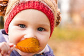 Beautiful baby portrait outdoor against autumn nature — Stock Photo