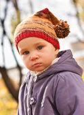 Beautiful baby portrait outdoor against autumn nature — Stock Photo