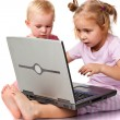 Children playing on laptop — Stock Photo