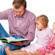Stock Photo: Father reading book to his children