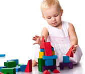 Beautiful baby building a castle — Stock Photo