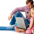 Father with children playing on laptop — Stock Photo