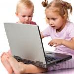Children playing on laptop — Stock Photo #4379988
