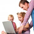 Father with children playing on laptop — Stock Photo #4379995