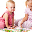 Children solving jigsaw puzzle isolated on white — Stock Photo #4379998