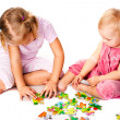 Children solving jigsaw puzzle — Stock Photo