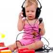 Baby with headphones and microphone — Stock Photo