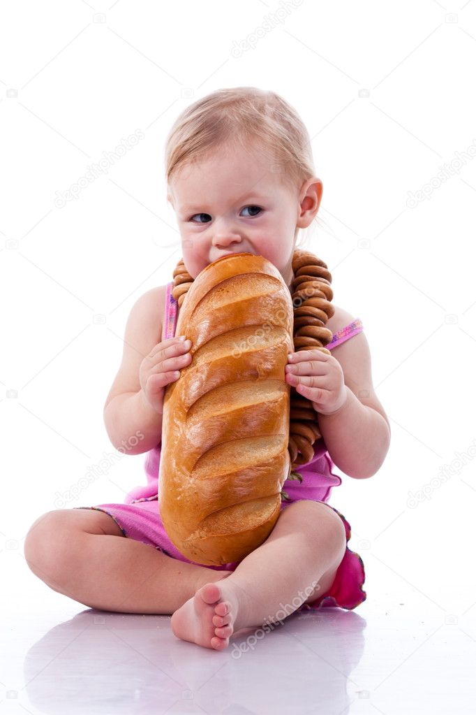Baby biting a loaf of bread in roll beads isolated on white  Stock Photo #4450668