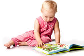 Beautiful baby girl reading a book — Stock Photo