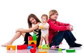 おもちゃで遊んでの家族 — ストック写真