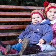 Children sitting on a bench — Stock Photo