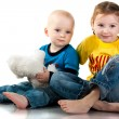Brother and sister sitting smiling — Stock Photo #4595993