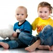 Brother and sister sitting smiling — Stock Photo #4596000