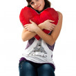 Beautiful girl holding a red heart — Stock Photo #4596008