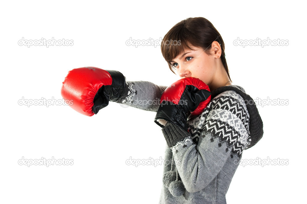 Beautiful girl in boxing gloves punching isolated on white — Stock Photo #4607728