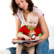 Royalty-Free Stock Photo: Mother reading to her child