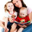 Mother reading to her children — Stock Photo #4635902