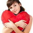 Beautiful girl with heart shaped red pillow — Stock Photo #4635931