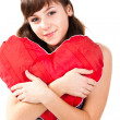 Royalty-Free Stock Photo: Beautiful girl  with heart shaped red pillow