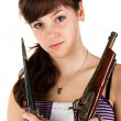 Beautiful girl with a gun and knife posing — Stock Photo