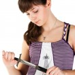 Beautiful girl with a knife pensive — Stock Photo
