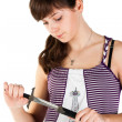 Beautiful girl with a knife pensive — Stock Photo #4745627