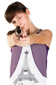 Beautiful girl with a gun shooting straight — Stock Photo