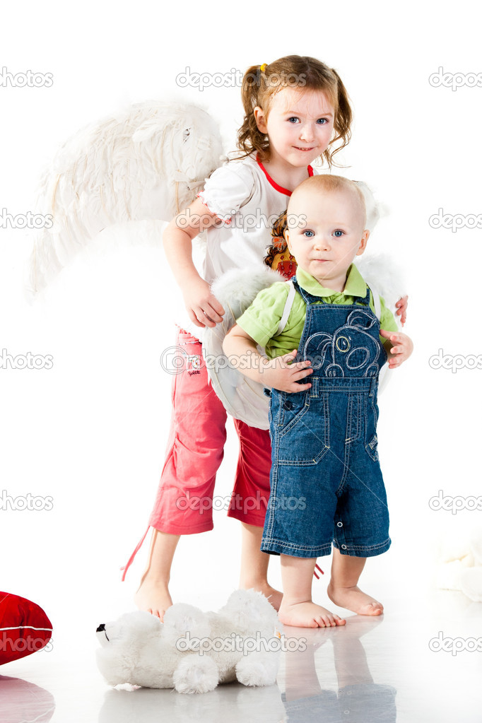 Brother and sister in angel wings isolated on white  Stock Photo #4745652