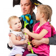Stock Photo: A young father playing with children