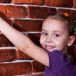 Beautiful girl leaning against the break wall — Stock Photo