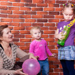 Grandmother playing with her grandchildren — Stock Photo