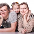 Happy seniors couple with grandchild — Stock Photo #5103018