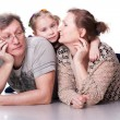 Happy seniors couple with grandchild — Stock Photo