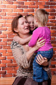 Grandmother playing with her grandchildren — Stockfoto