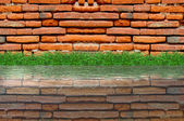 Old brick wall and green grass on white background — Stock Photo