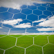 Stock Photo: Soccer goal under the blue sky